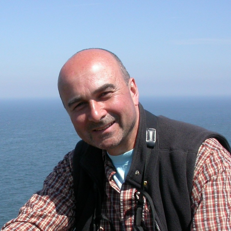 Headshot of Philip Lymbery against the blue sea and sky
