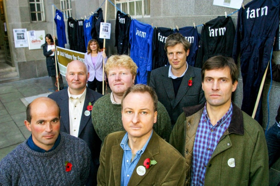 Robin Maynard, MP Zac Goldsmith and four progressive farmers stand outside Defra HQ. In the background is a washing line with 11 farmers' boilersuits, representing the 11 farmers which were going out of business each week (hung out to dry)
